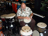 Jim moisturizing the heads of in-stock congas and bongos
